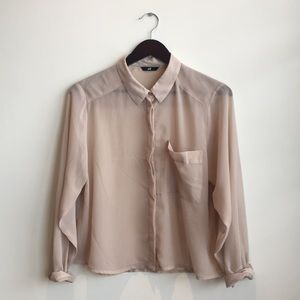 Taupe-colored sheer blouse